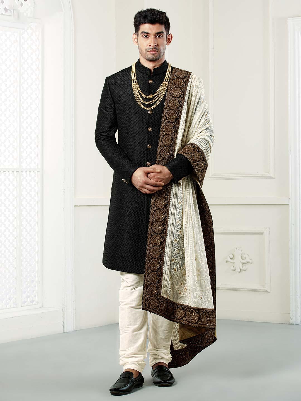 Black solid wedding wear raw silk sherwani?imgeng=w_400