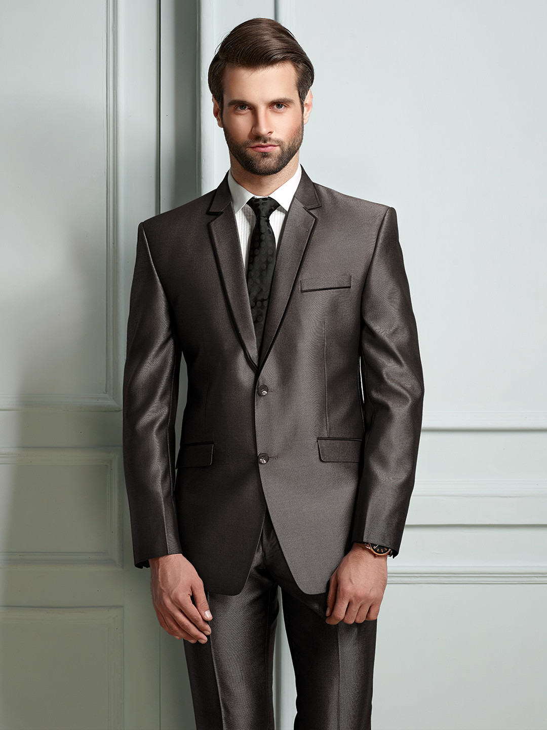 Brown solid party wear official suit?imgeng=w_400