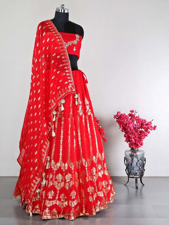 Latest unstitched red raw silk lehenga choli for wedding?imgeng=w_400