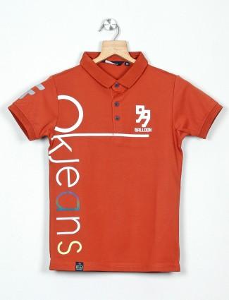 99 Balloon rust orange printed polo t-shirt