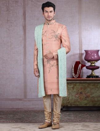 Alluring peach sherwani for wedding