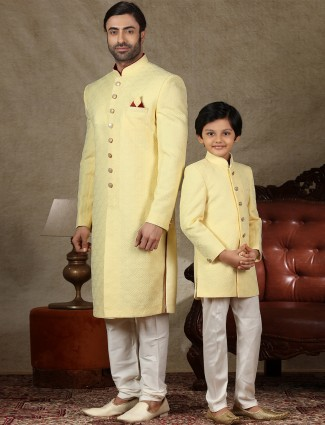 Alluring yellow sherwani in silk for father and son