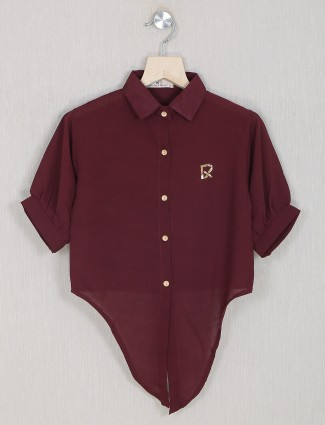 An casual style maroon top for casual events