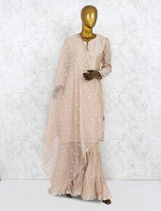Beige colored cotton silk punjabi sharara suit