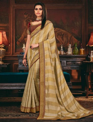 Beige colored silk saree for festive look