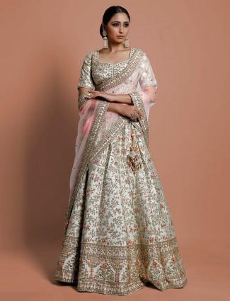 Bridal wear cream designer lehenga choli in silk