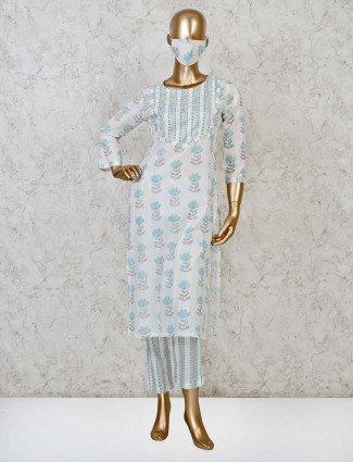 Casual cream cotton pant suit with matching mask