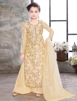 Cream hued designer punjabi palazzo suit