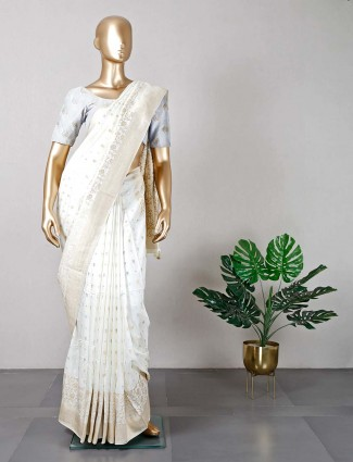 Cream muga silk saree for festive occasions