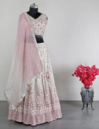 Designer cream pink net lehenga choli for wedding