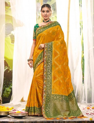 Designer gold silk saree for wedding with zari weaving pallu