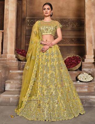 Excellent yellow colored wedding wear semi stitched lehenga choli