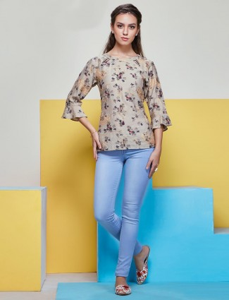 Fancy printed top in beige color with ruffle sleeves