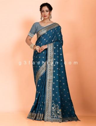 Festive get together dola silk saree in rama blue