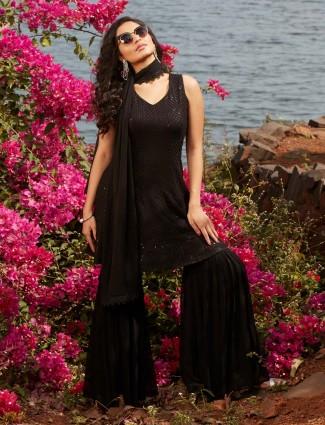 Fantastic black georgette punjabi style wedding wear sharara suit