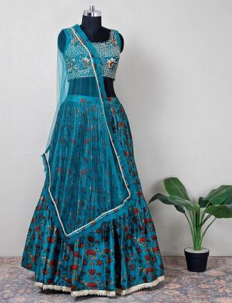 Teal green net designer lehenga choli for wedding