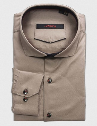 I Party beige colored shirt