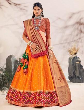 Latest orange silk zari inflated unstitched lehenga for wedding