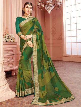 Green printed georgette sari for festive