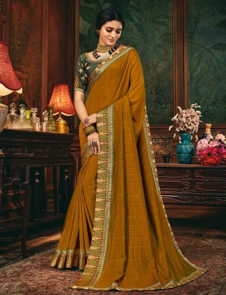 Mustard raw silk saree for party session