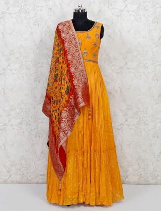 Mustard yellow silk anarkali salwar suti for wedding