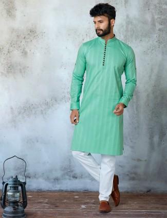 New green cotton stand collar kurta suit