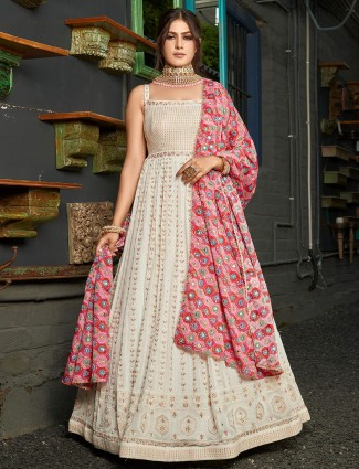Off white floor length gown in georgette fabric