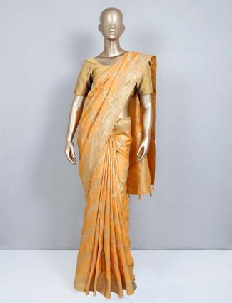 Orange designer latest muga silk saree for wedding functions