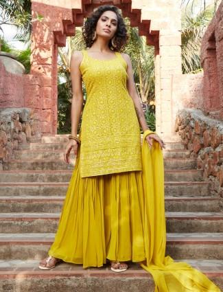 Ornate yellow georgette punjabi style wedding wear sharara suit