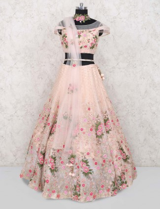 Peach hue net wedding wear lehenga choli