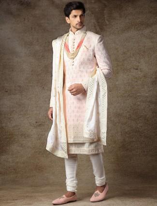 Pink raw silk fabric sherwani for wedding occasions