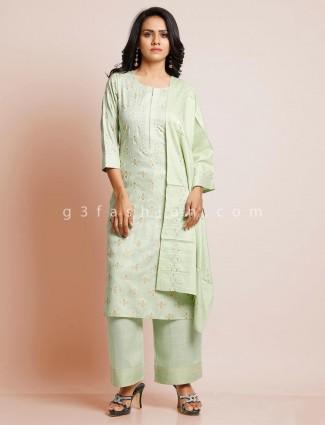 Pista green cotton suit for festive look