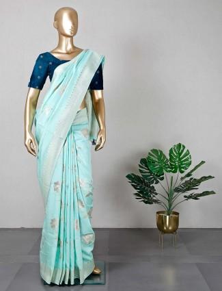 Sea green dola silk saree for festive days