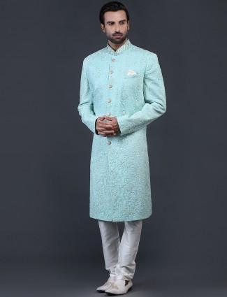 Sea green net fabric sherwani for wedding occasions