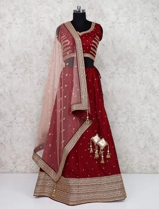 Silk fabric maroon hue wedding semi stitched lehenga choli