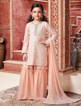 Sophisticated peach tint sharara suit fot little girls