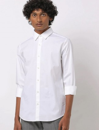 UCB presented white solid style shirt