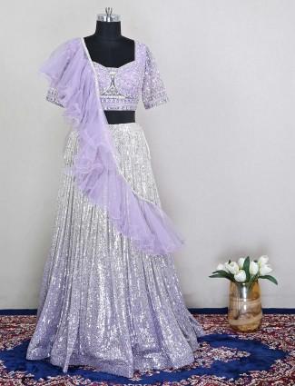 Violet net wedding wear lehenga choli