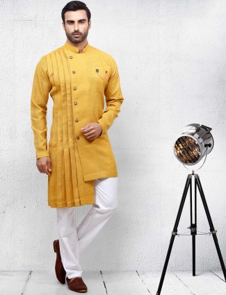 Yellow color solid pleated pattern kurta suit