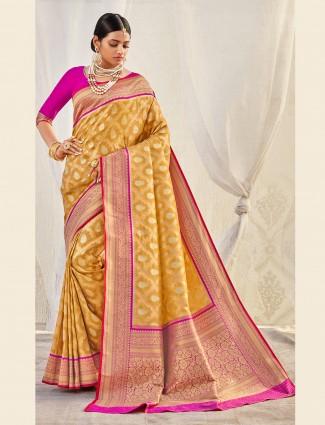Yellow colored banarasi tissue silk saree for wedding