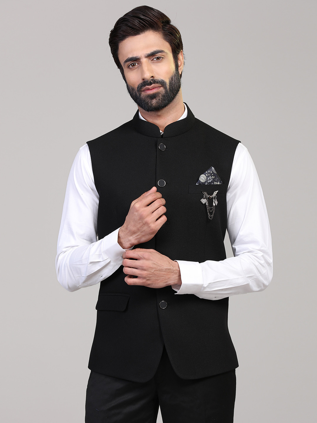 Solid black knitted waistcoat?imgeng=w_400