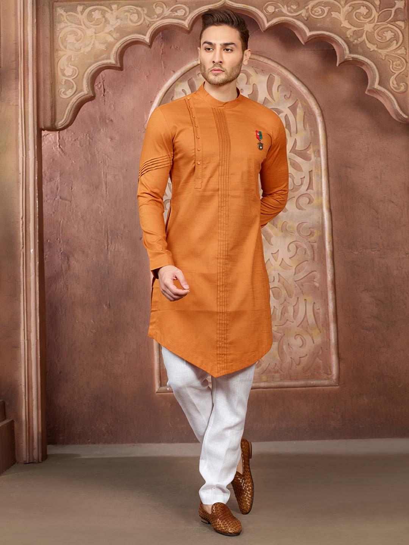 Wedding wear orange hue cotton silk kurta suit?imgeng=w_400