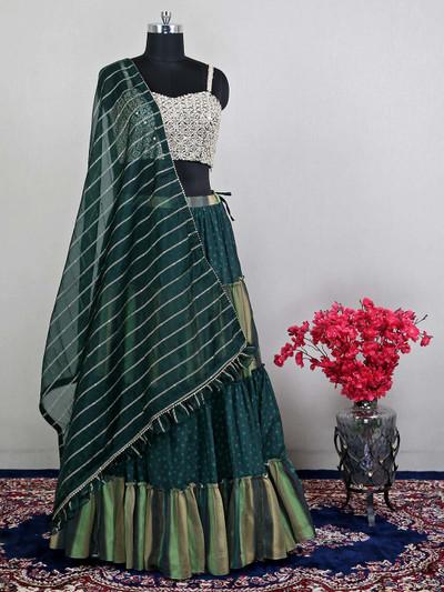 Alluring wedding wear dark green lehenga with handwork details