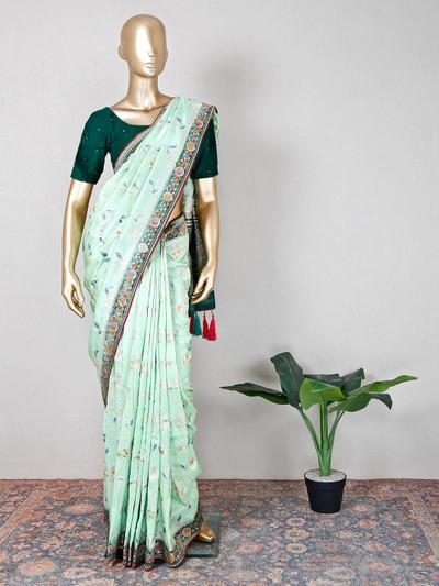Beautiful pista green muga silk festive wear saree