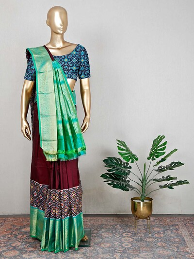 Designer maroon wedding wear saree in patola silk