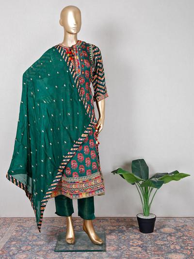 Festive wear bottle green raw silk pant suit