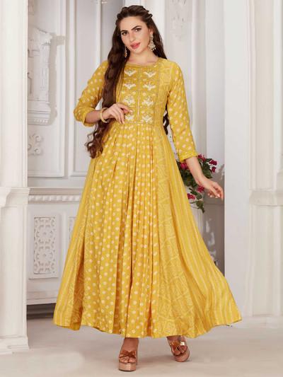 Festive wear yellow colour round neck kurti