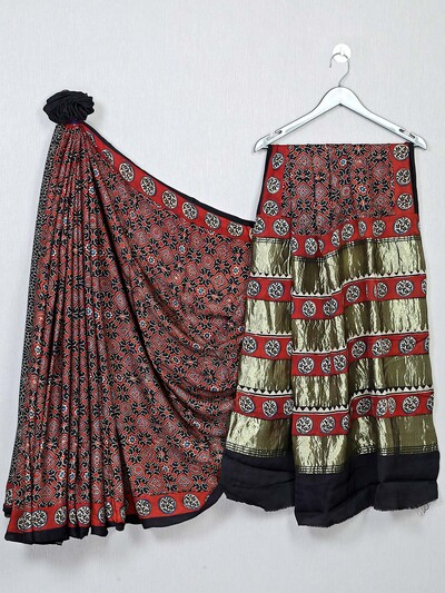 Gorgeous black color festive wear bandhej saree
