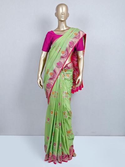 Green muga silk saree for wedding look