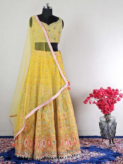 Iconic yellow wedding wear lehenga choli for feminism